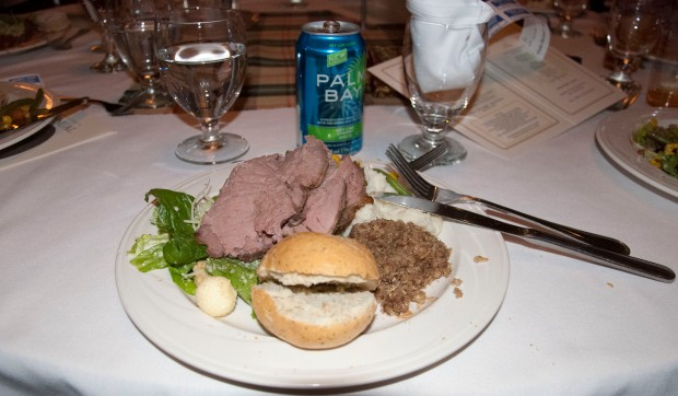 The haggis is to the right of the bun and bellow the mashed potatoes