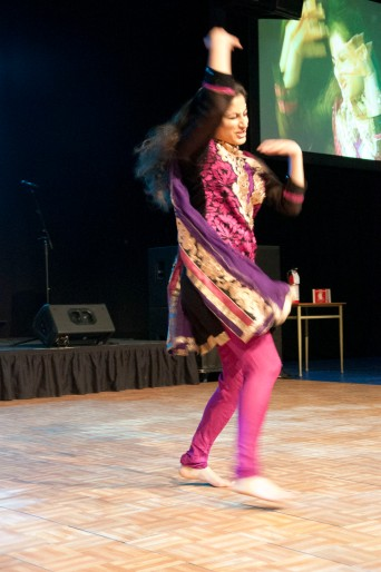 An Indian dancer captivates the crowd with her energetic moves.