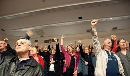 Audience members raised their fists as they sang alongside Ezra Kwizera.